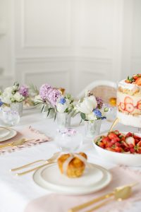 blush napkins and cold rimmed china