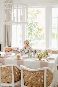 little girl eating strawberry at dinning room table