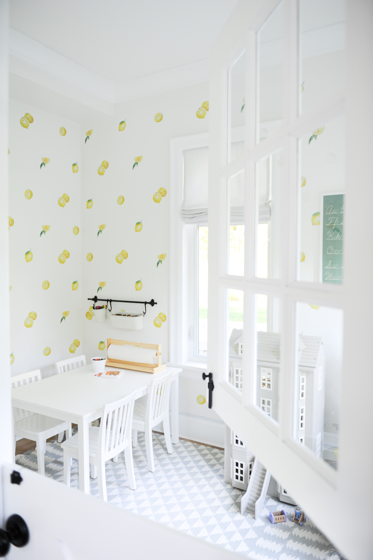 Airy kids playroom with lemon wallpaper