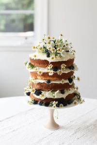layered naked cake with small daisies