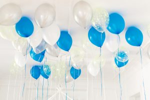 blue and white balloons on celling