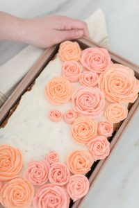 buttercream roses on sheet cake