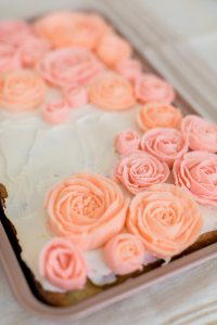 buttercream roses piped on sheet cake