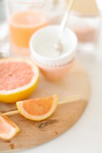 grapefruits on wooden cutting board