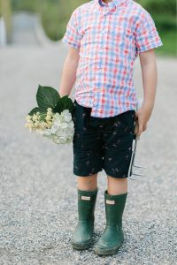 little boy, boots and flowers