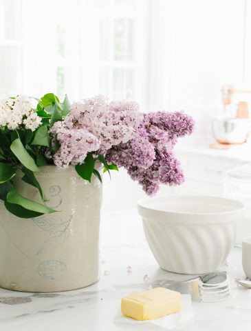 lilacs in crock on marble countertop