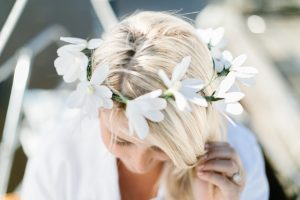crepe paper daisy crown on blond hair