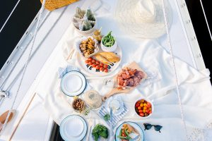 overhead of summer picnic on sailboat