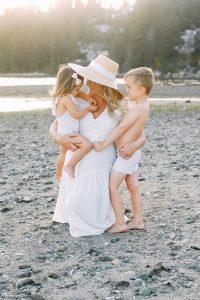 mom on beach with two kids