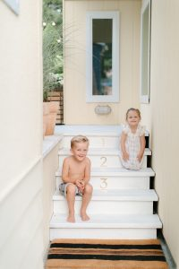 kids laughing on porch steps