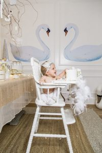 Baby girl's first swan lake birthday party eating cake monika hibbs