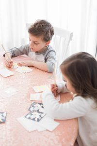Kids writing Valentines cards