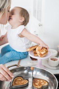 Mother daughter making pancakes