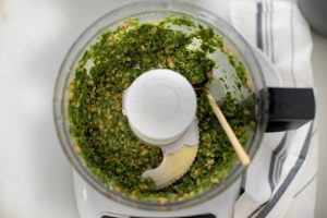pesto with spoon in it