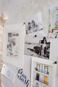close up of family photos on pin board