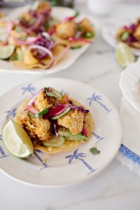 crispy cauliflower tostadas on a palm plate