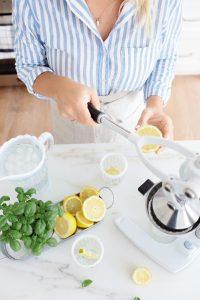 Pressing lemons for lemonade