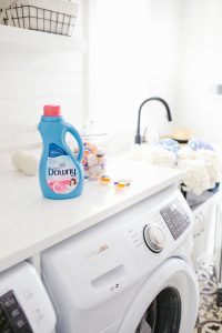 Bottle of Downy fabric conditioner in Monika's laundry room
