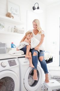 Monika in the laundry room with her son