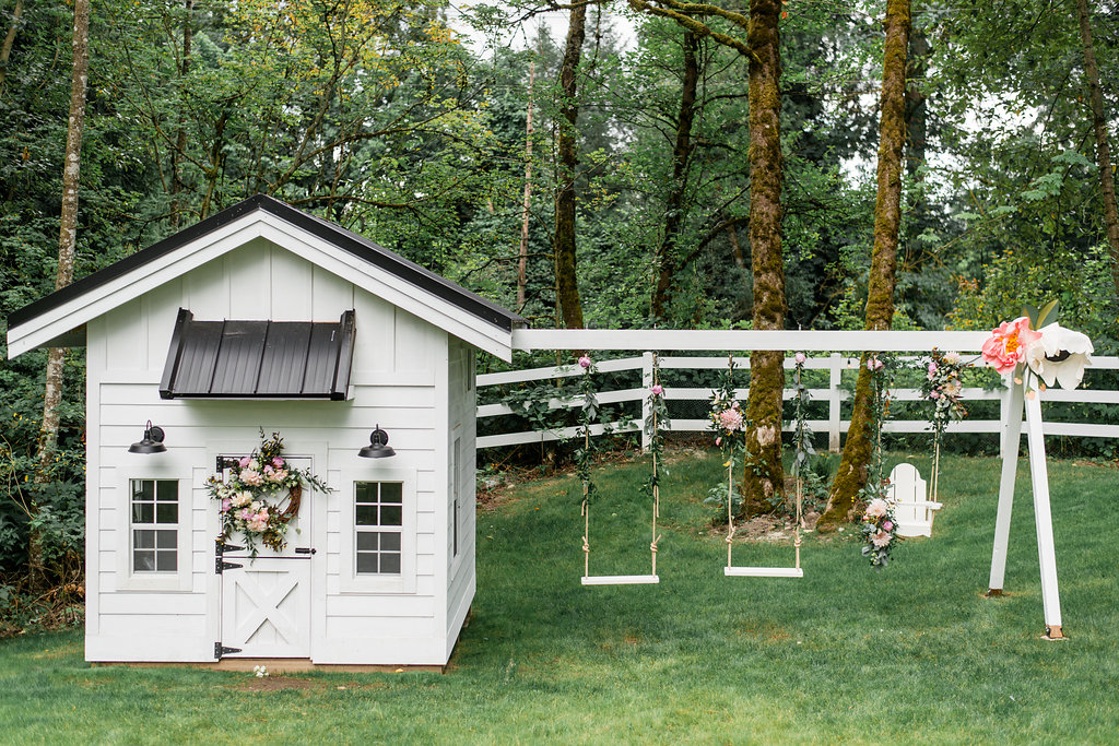 outdoor play house with swings