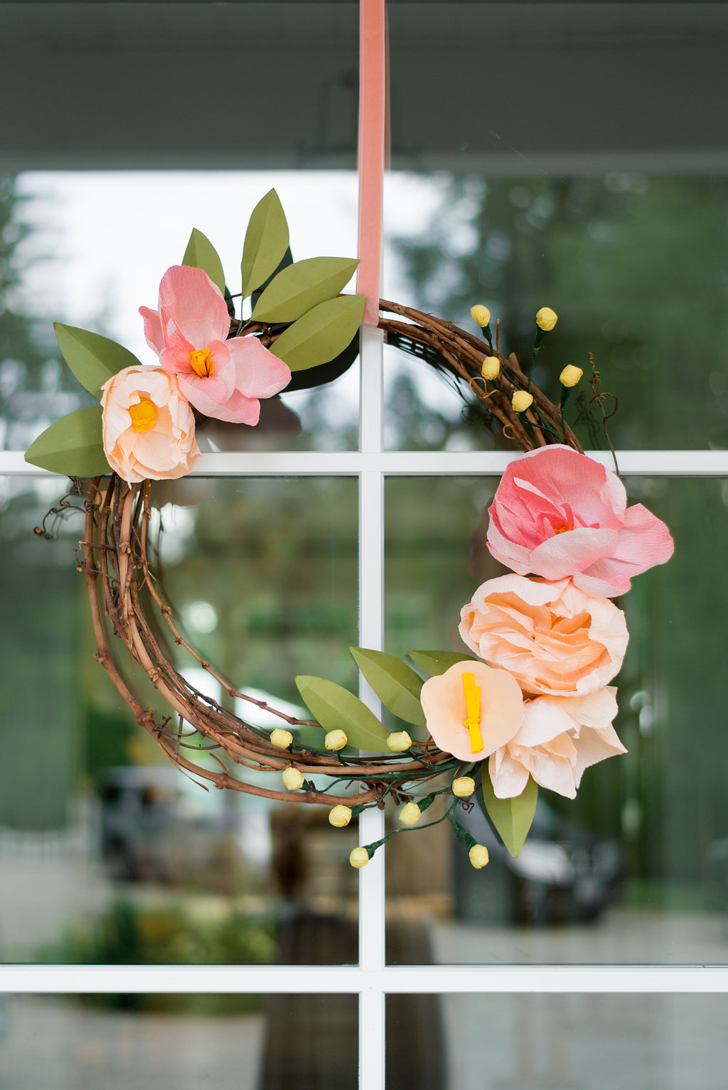 paper floral wreath on door