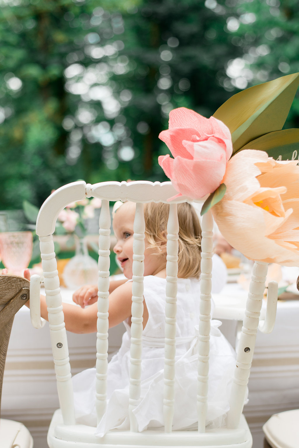 paper flowers on Lillya's high chair