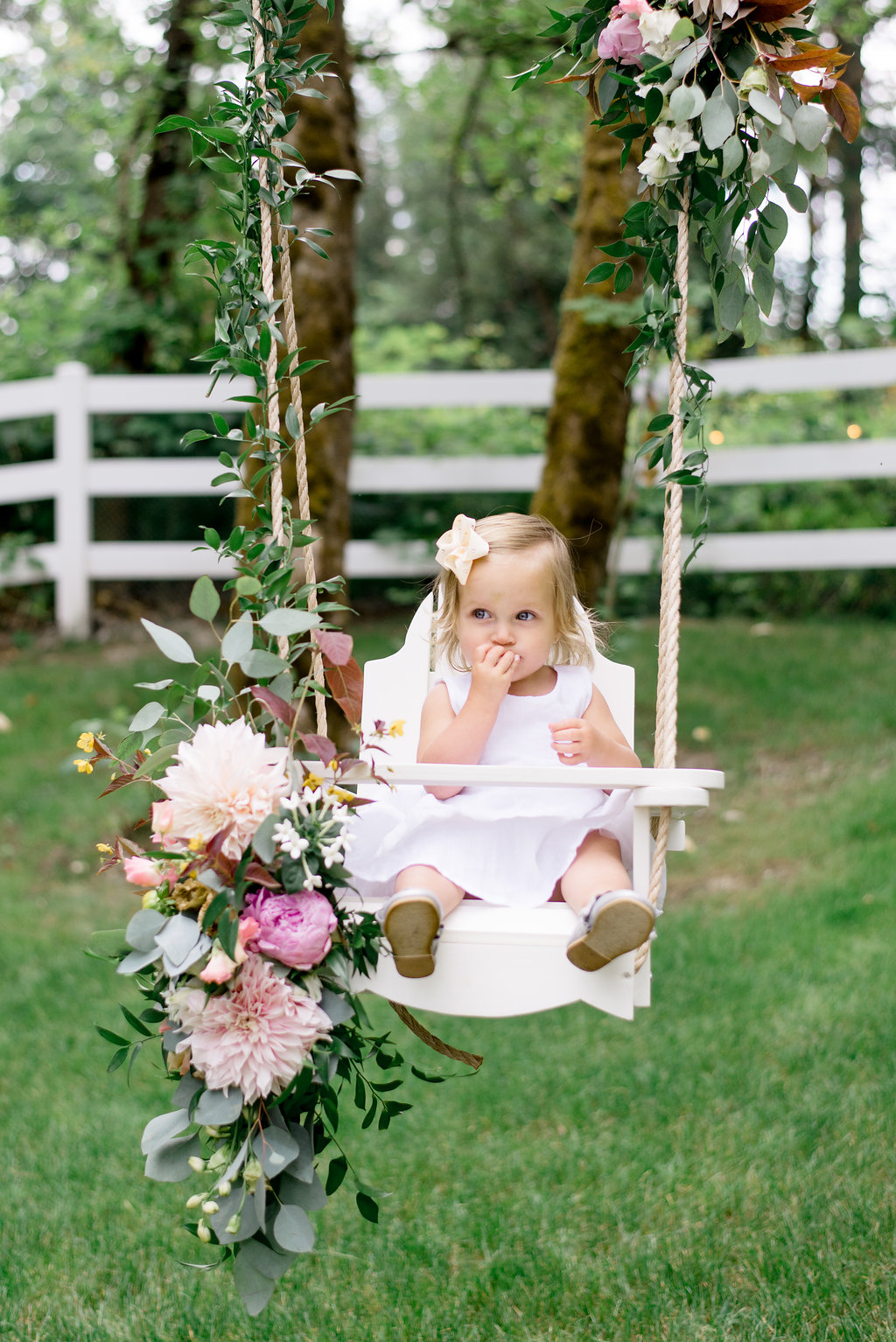 Lillya sitting on floral swing
