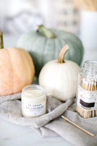 pumpkins, candle and matchsticks
