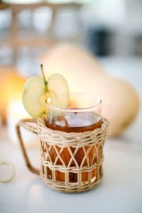 wicker mug with apple cider