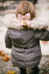 Little girl playing in winter coat