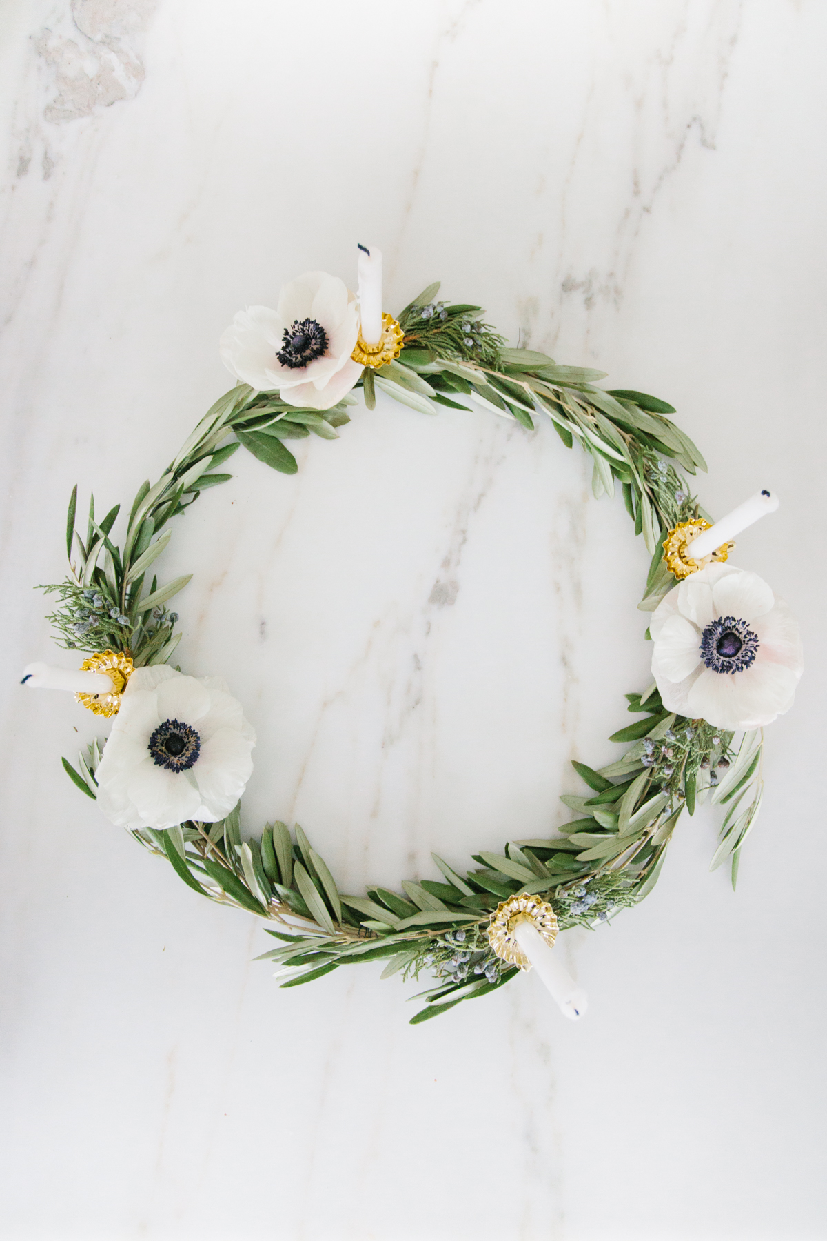 olive branch wreath with candles and flowers