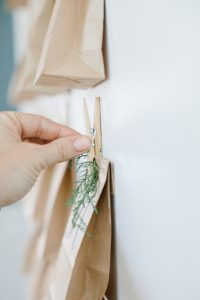 pinning on advent bag to wall