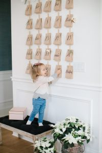 advent on wall with little girl