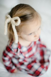 white yarn bow in hair