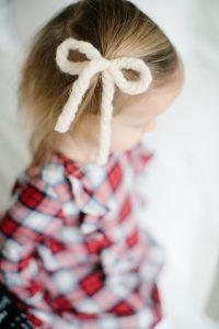 white yarn bow in hair