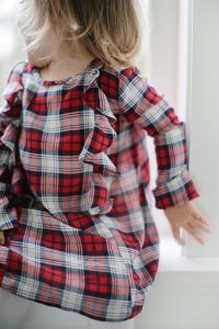 toddler girl in plaid dress