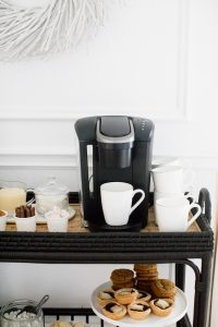 keurig coffee machine, white mugs and beverage toppings