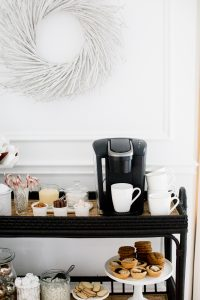 keurig coffee machine, stacked mugs and toppings