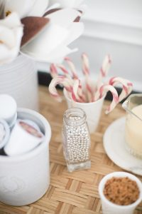 candy canes in cup and edible silver balls