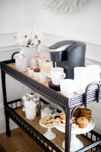 black bar cart, stacked mugs keurig coffee machine