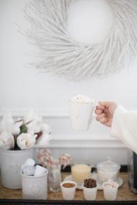 festive beverage station mug being held