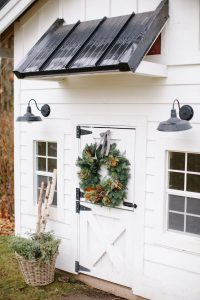 White playhouse with christmas wreath