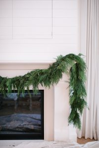 installing fresh garland to mantel