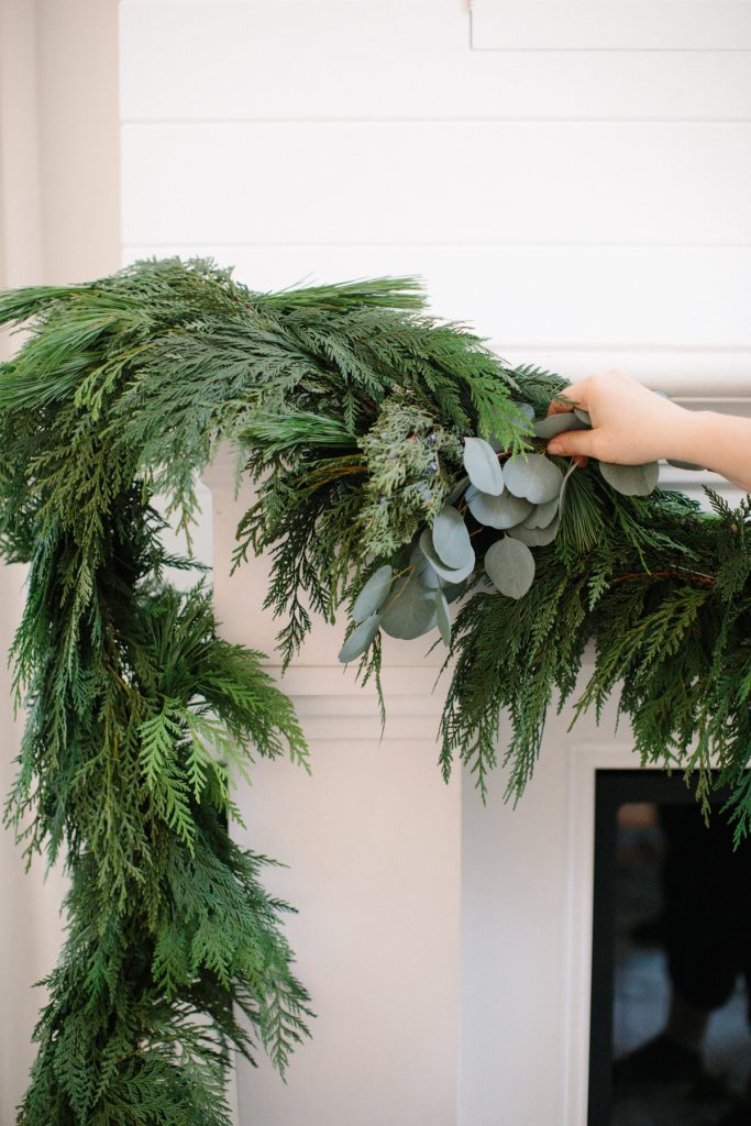 adding eucalyptus into garland