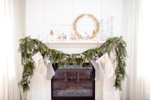 Mantel with stockings and glitter homes