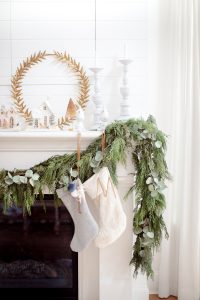 garland on mantel, stockings and glitter homes
