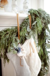 detail of hung stocking and natural green garland