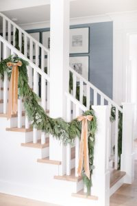 garland on banister with bows