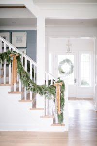 garland on banister with muted toned bows