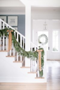 holiday garland with bows entryway